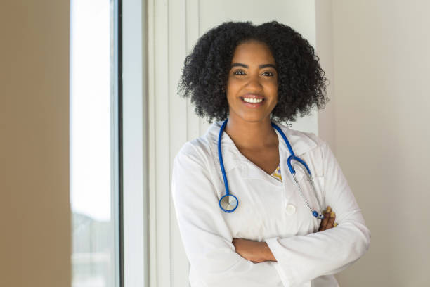 African American Healthcare Professionals Portrait of a young confident healthcare professional. female doctor stock pictures, royalty-free photos & images