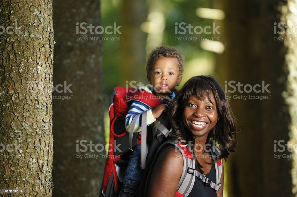 African American Hiker Carrying Baby/ Toddler On Her Back royalty-free stock photo