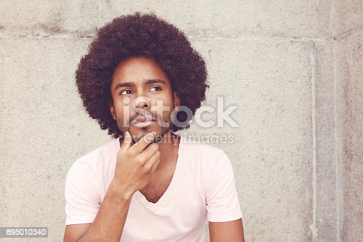 istock African american hipster man solving problem 895010340
