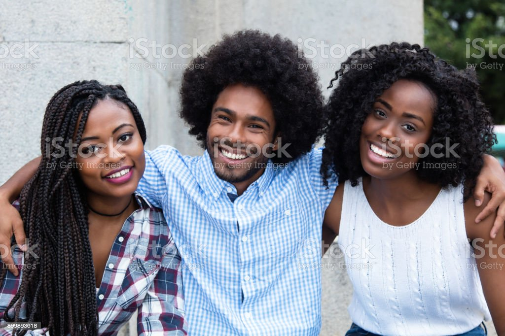 African american hipster man with two beautiful woman stock photo