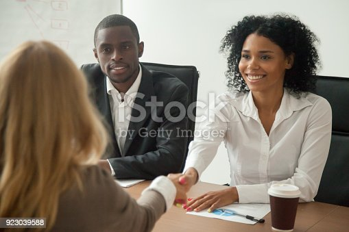 istock African american hr team welcoming female applicant at job interview 923039588