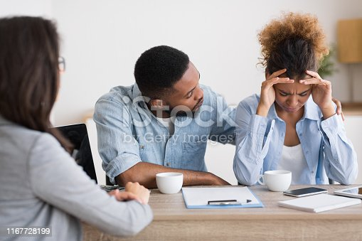 istock African American Husband Comforting Desperate Wife Crying On Family Counseling 1167728199