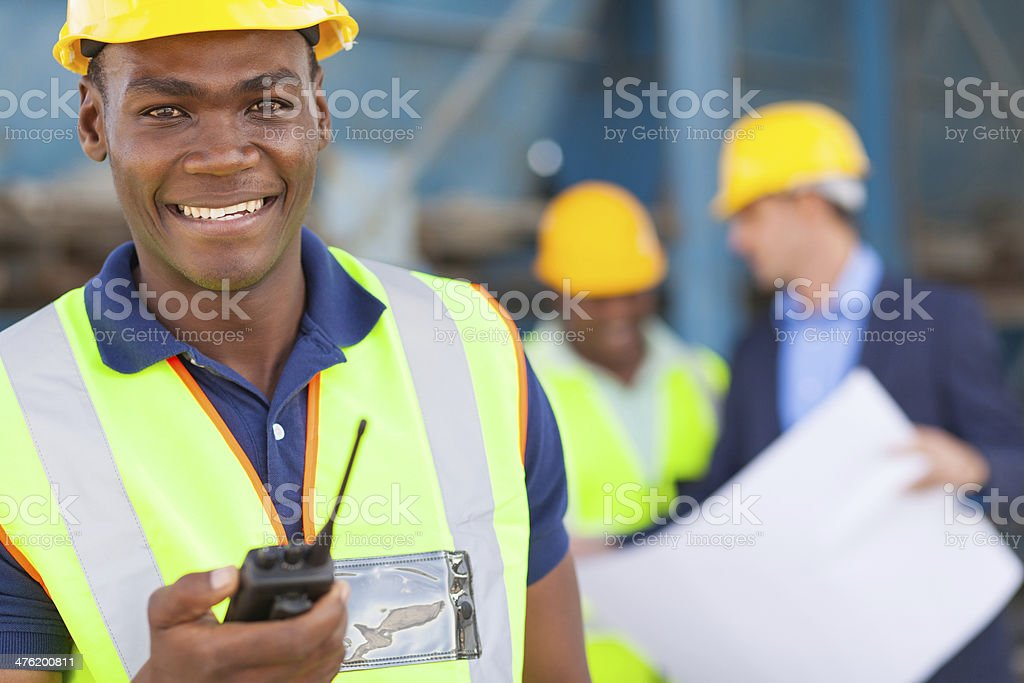 african american industrial worker with walkie talkie stock photo