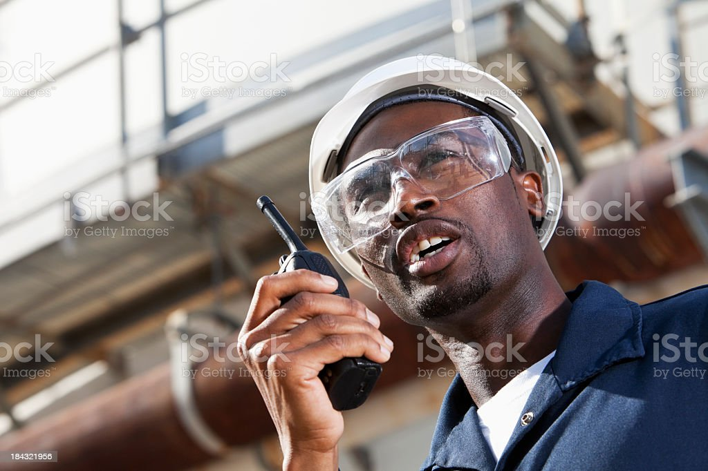African American industrial worker with walkie-talkie stock photo