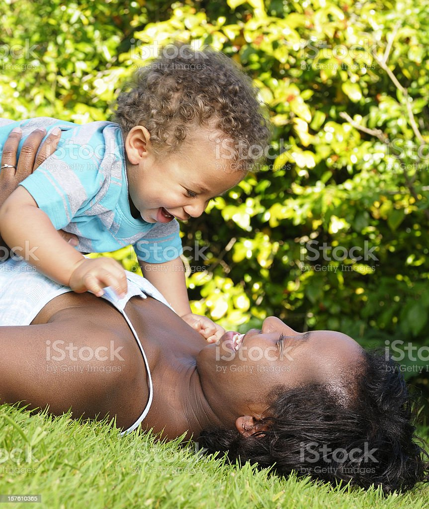 African American Interacting With A Baby in The Park royalty-free stock photo