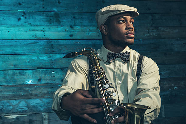 African american jazz musician with saxophone. stock photo