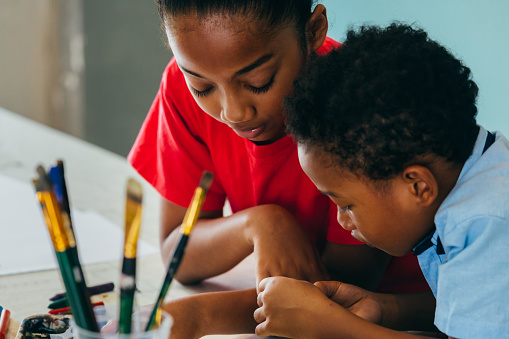istock African American kids drawing and painting 1153255882