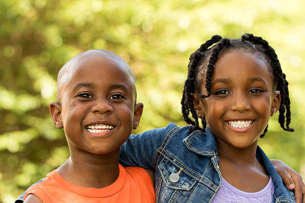 African American kids smiling. Brother and sister looking at the camera smiling. sister stock pictures, royalty-free photos & images