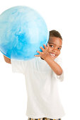 """""""An African American 5 year old boy holds a big blue ball as if he is getting ready to throw it, or just caught it"""""""