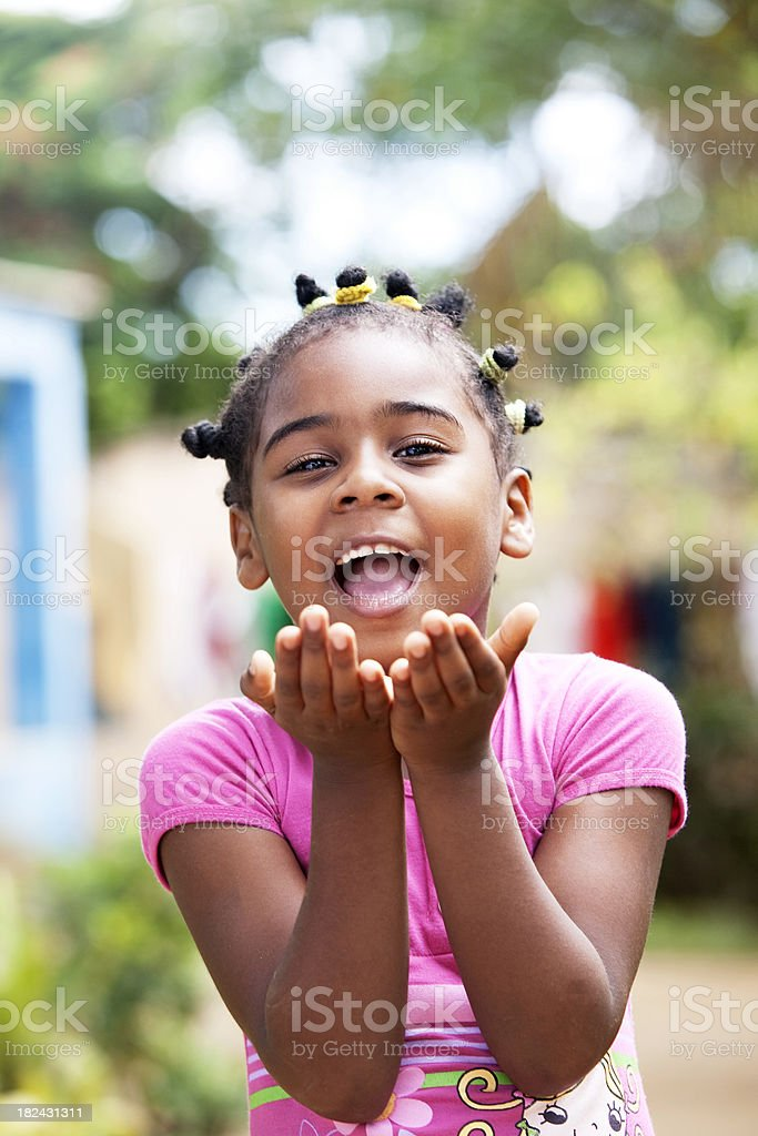 African American Little Girl Blowing a Kiss stock photo