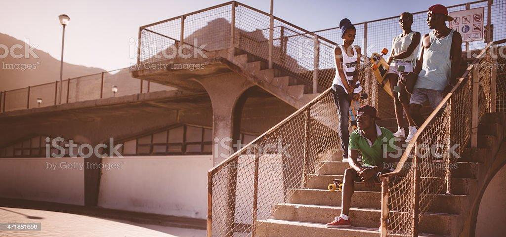 African American longboarders looking cool in an urban setting stock photo