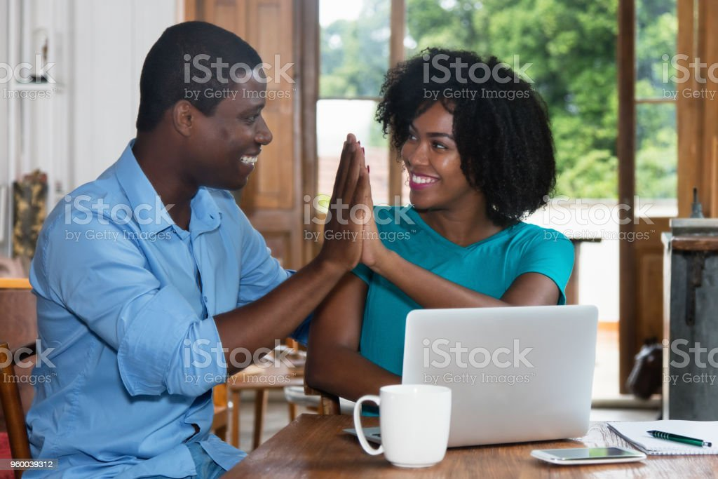 African american love couple give high five stock photo