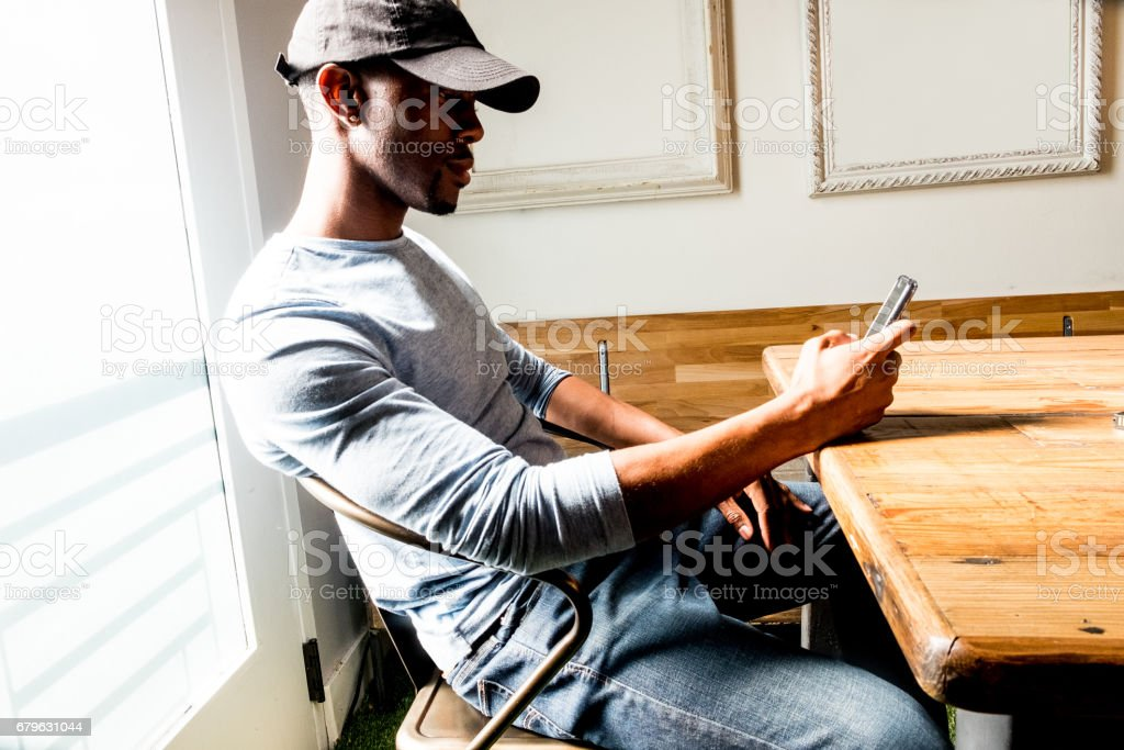African American Male Checks His Phone stock photo