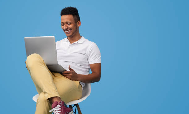 African American male doing homework stock photo