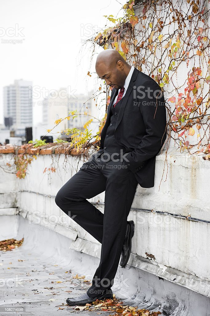 African American Male Fashion Model in Suit on City Rooftop royalty-free stock photo