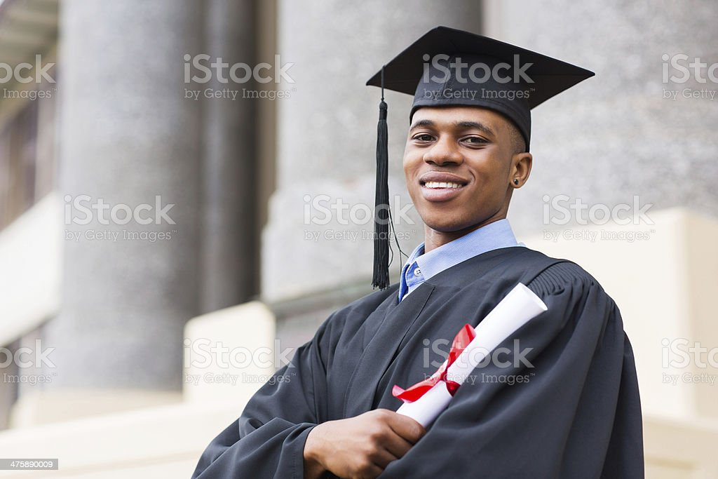 african american male graduate standing outside college stock photo