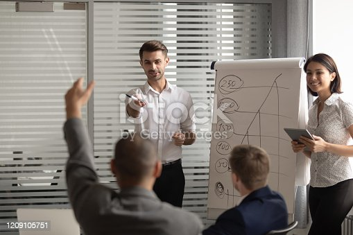 1031235468 istock photo African american male manager raising hand, asking question at seminar. 1209105751