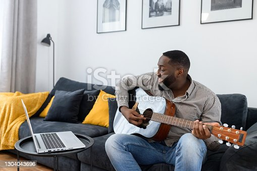 istock African American male musician playing guitar 1304043696