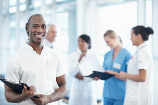 African American Male Nurse With Medical Team In The -4532