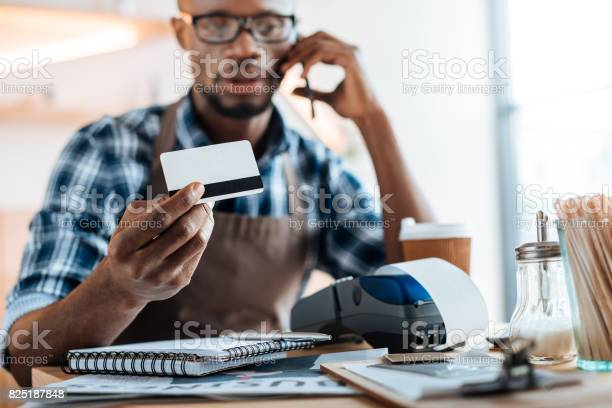 African american male owner working with credit card reader and in picture id825187848?b=1&k=6&m=825187848&s=612x612&h=cmacgpnotmsffghmvbps7f4sbzf ggrcbxeaouxgwxa=