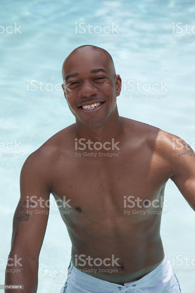 African American Male Smiling in Pool royalty-free stock photo