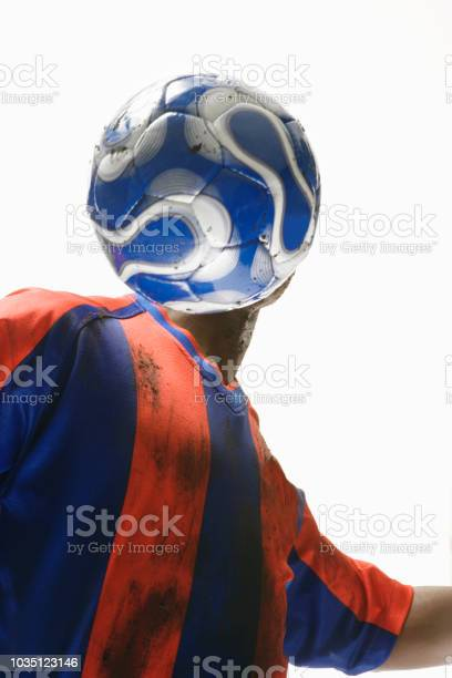 African american male soccer player with ball in front of face picture id1035123146?b=1&k=6&m=1035123146&s=612x612&h=idzjgu aihu7irpesd29b2xqdnwo6ecdrenzxvi7 n8=
