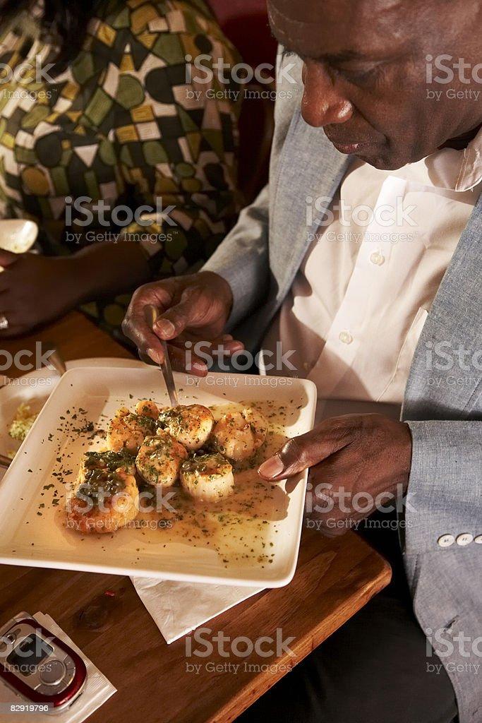 African American man at restaurant royaltyfri bildbanksbilder