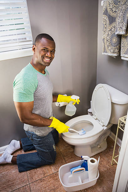 Royalty Free African Man Cleaning Toilet Pictures Images And Stock - Bathroom cleaner person