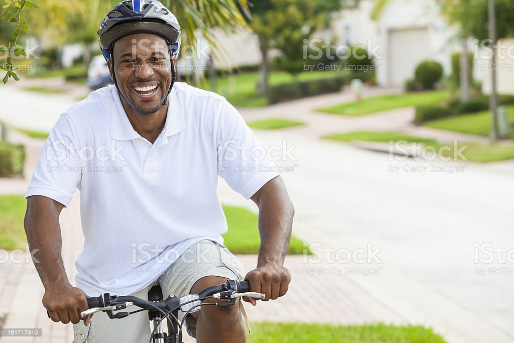 African American man cycling in the summer stock photo