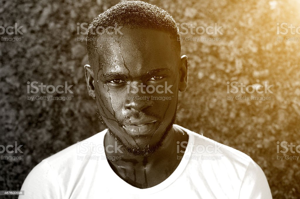 African american man dripping with sweat stock photo