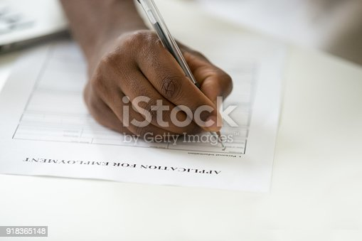 636681940istockphoto African american man filling employment application form, close up view 918365148
