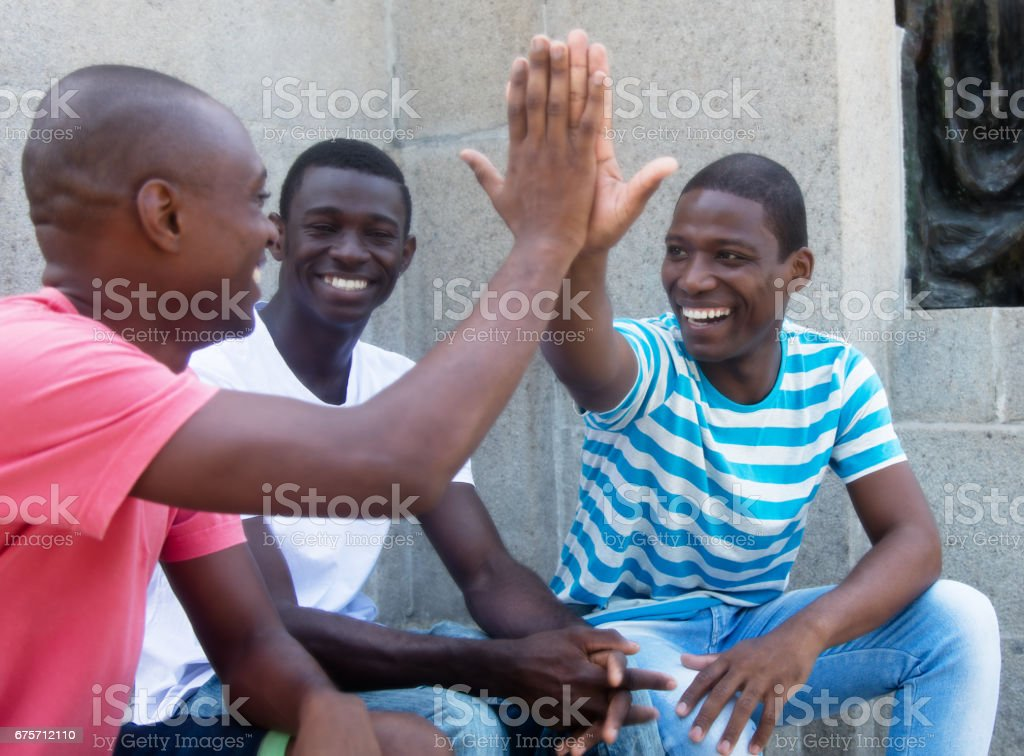 African american man give high five stock photo