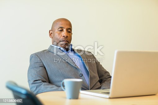 539437954 istock photo African American man having a difficult time at work. 1213806452