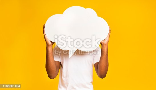 istock African american man holding an empty speech bubble 1168361494