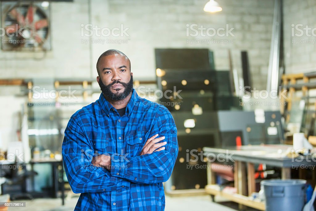African American man in a workshop stock photo