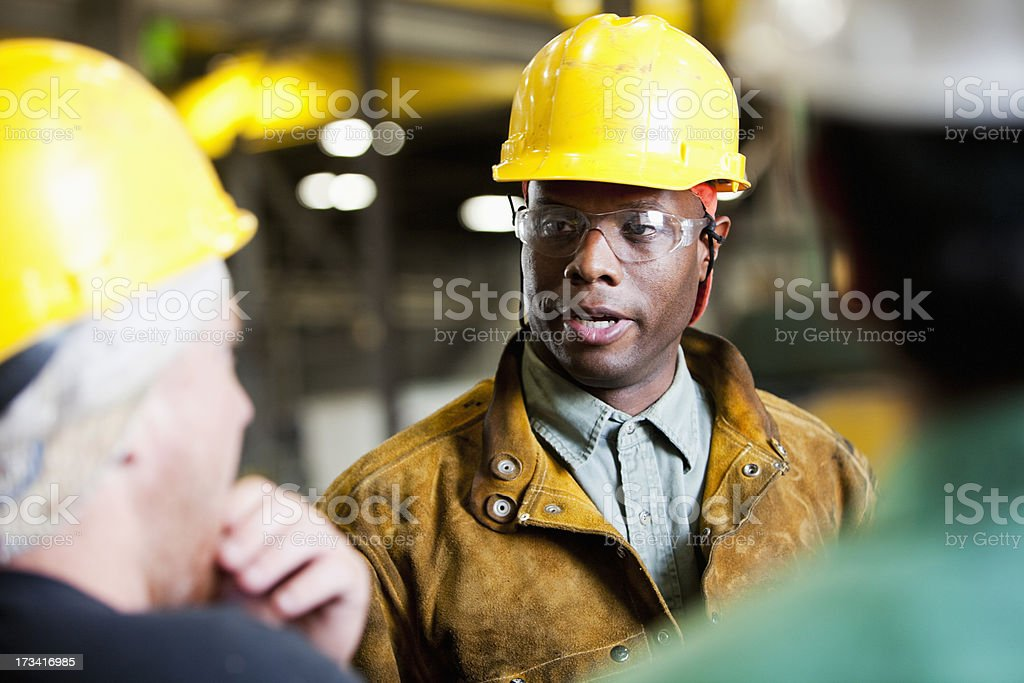 African American man in a yellow hard hat stock photo