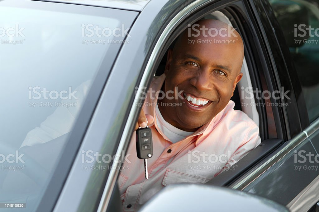 African American man in his new car stock photo