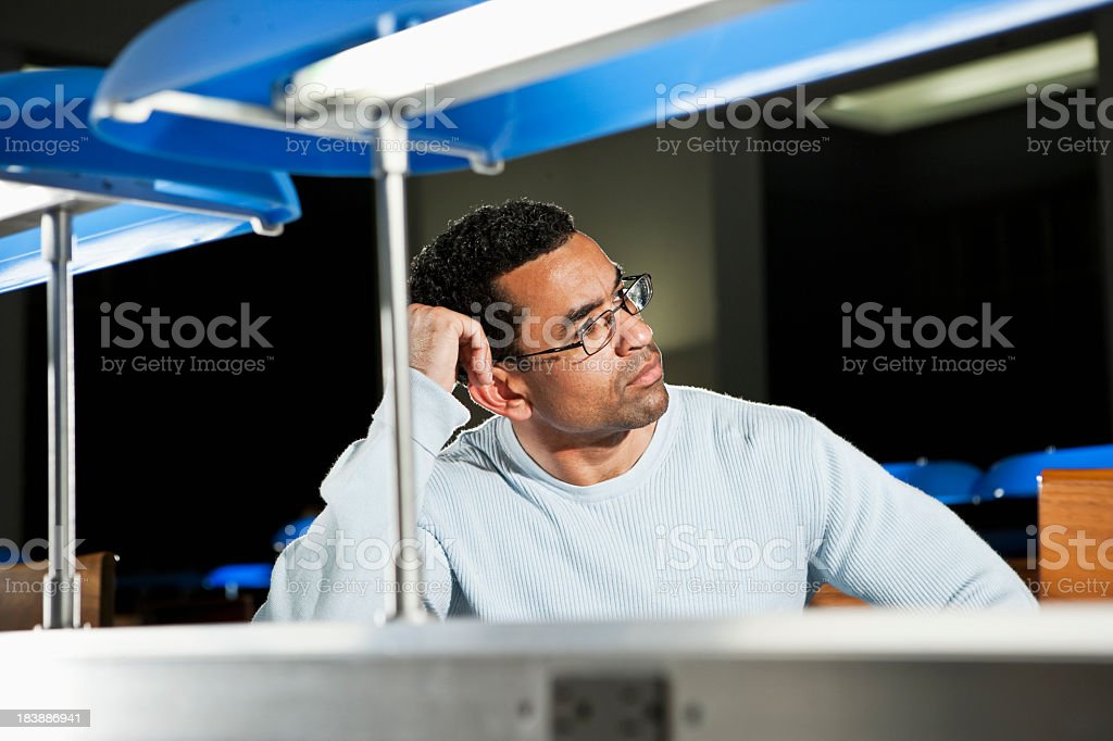 African American man in library stock photo