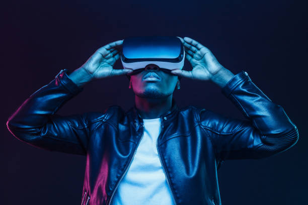 african american man in vr glasses, watching 360 degree video with virtual reality headset isolated on black background - virtual reality stock pictures, royalty-free photos & images