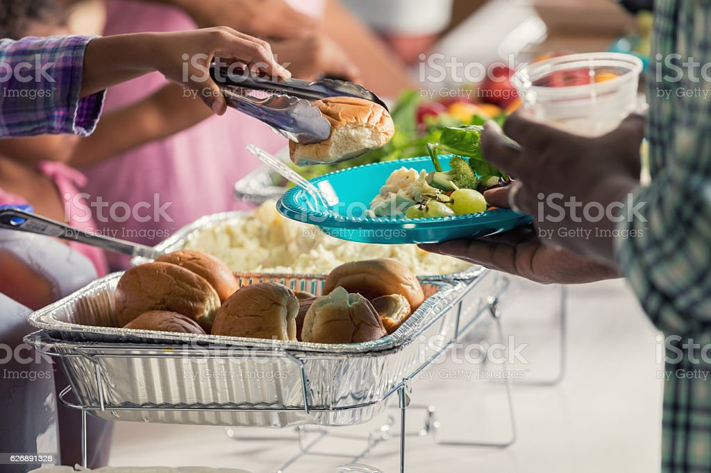 African American man is served a meal in soup kitchen stock photo