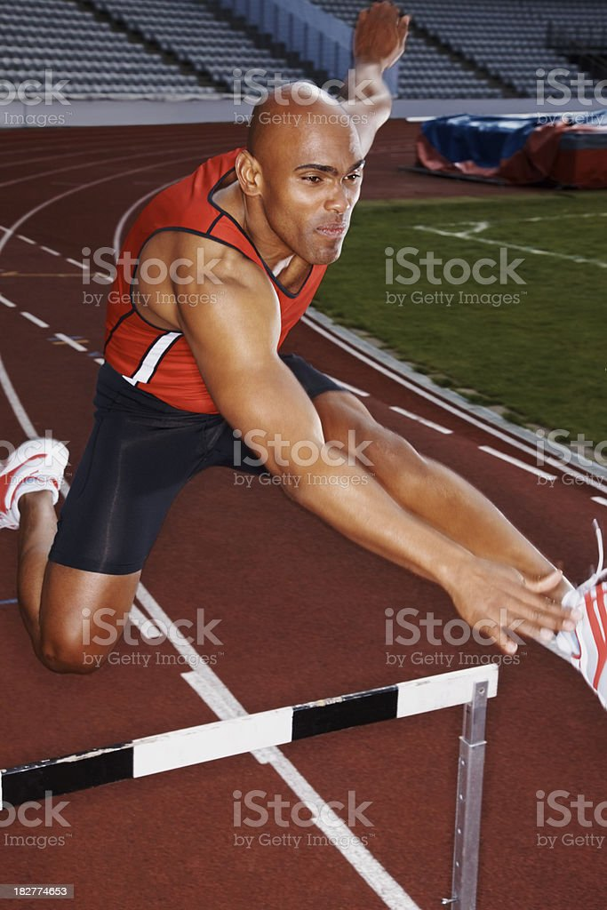 African American man practicing hurdle jumping royalty-free stock photo