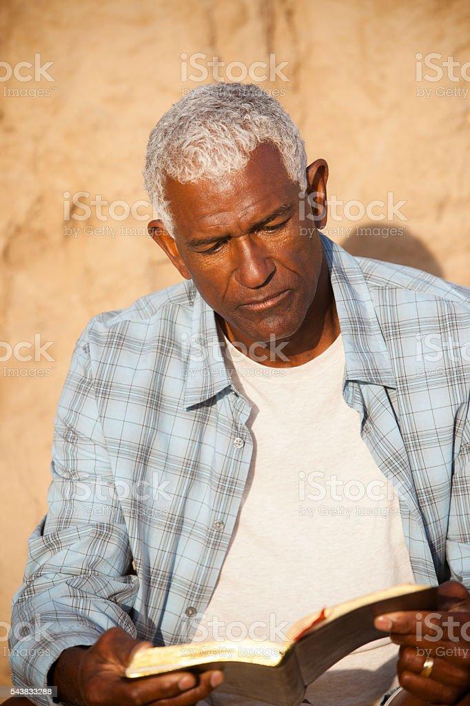African American Man Reading Bible stock photo