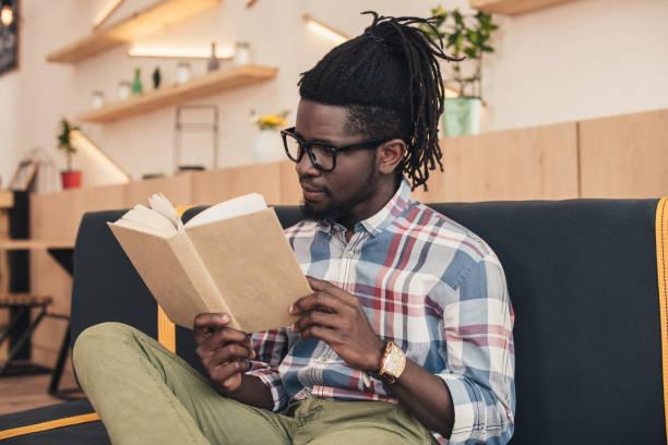 African american man reading book while sitting on sofa in cafe picture id961361358?b=1&k=6&m=961361358&s=612x612&w=0&h=ft54 z mfcyo5bp xt4ucegzml0s4aqvzyeeuhawt54=