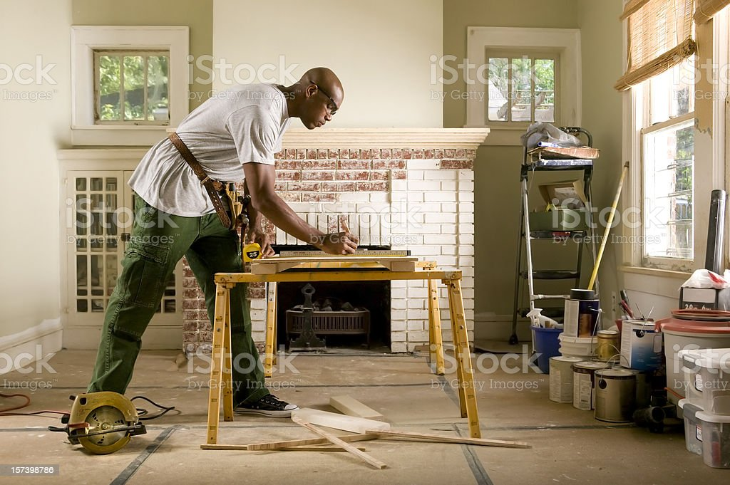 African American man renovating home interior. stock photo
