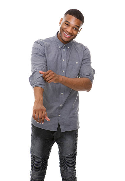 African american man smiling and rolling up sleeves stock photo