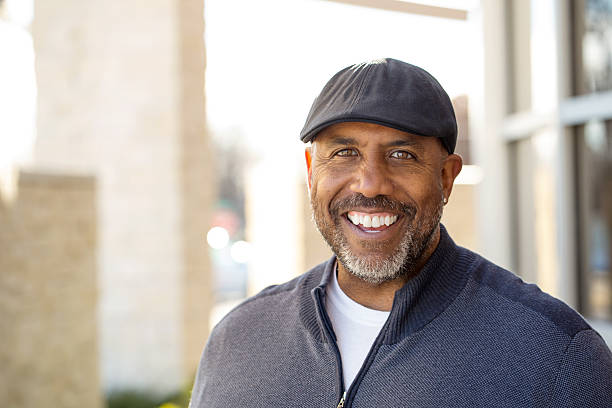 African American Man Smiling African American Man Smiling 55 59 years stock pictures, royalty-free photos & images