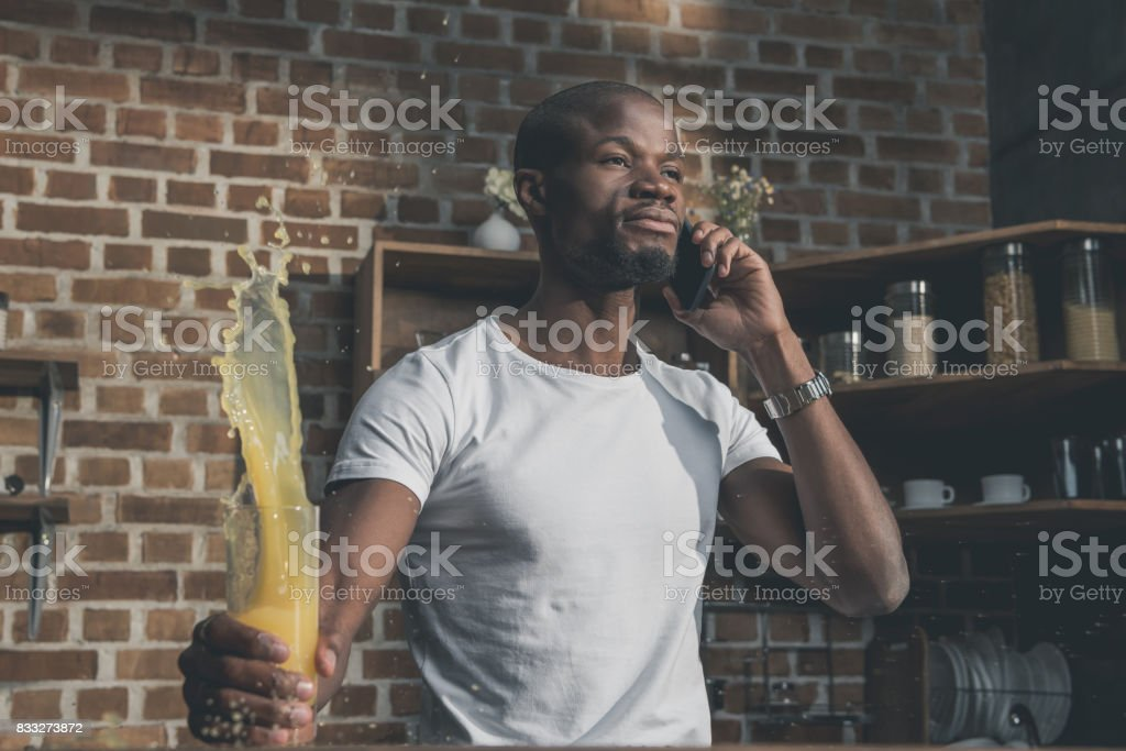 african american man talking on phone stock photo