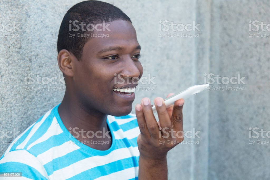 African american man using a smart phone voice recognition royalty-free stock photo