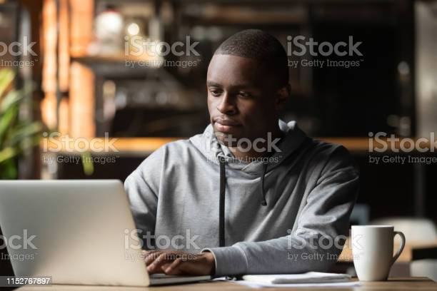 African american man using laptop in cafe looking at screen picture id1152767897?b=1&k=6&m=1152767897&s=612x612&h=x3j2wendjzbmrjnuv6nnvcf9d3jmkndyoqgphwccdnk=