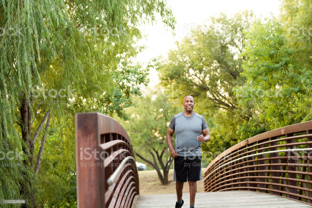 African American man walking in the park. royalty-free stock photo